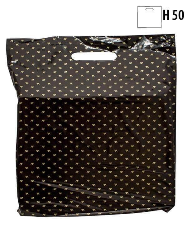 Plastpose med guldbladet mønster (B 40 x D 10 x H 50 cm.)
